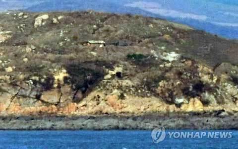 Triều Tiên nã đại bác vào Hàn Quốc, đốt cháy 60 nhà dân 20101123152847_b4