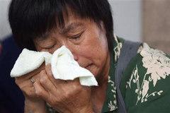 Người nhà nạn nhân MH370 phản ứng thế nào về tin mới?