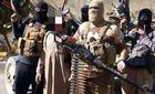 Vạch mặt tên đao phủ phì nộn khét tiếng tàn bạo của IS