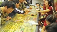 Vàng dò đáy, USD quay đầu giảm giá