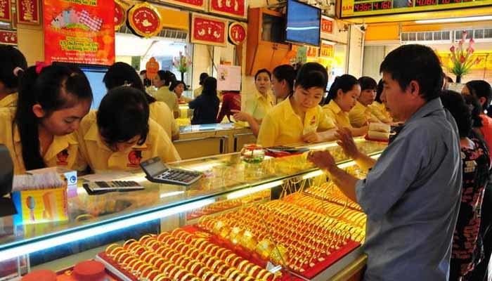Vàng giả Trung Quốc: Đổ xô đi bán, không ai dám  mua