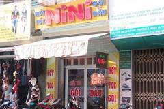 Ổ mại dâm trong tiệm hớt tóc có gắn chuông báo động