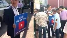 Thanh niên dán tiền khắp người cho dân giật giữa Sài Gòn