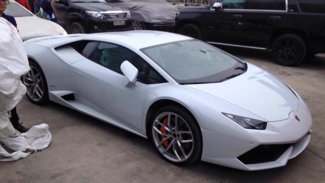 20160117082812 2 Siêu bò Lamborghini Huracan màu cam nổi bật đã bị bắt gặp tại cảng Đà Nẵng