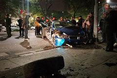 Tai nạn nghiêm trọng ở trung tâm Hà Nội, siêu xe BMW i8 nát bét