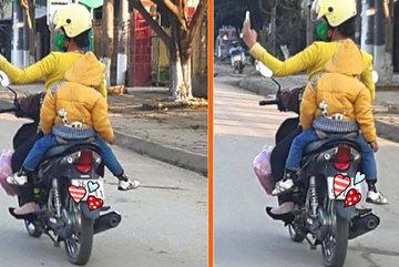 Hành động gây nguy hiểm cho con khi bố mẹ đi xe máy