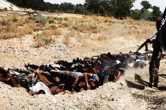 IS chôn sống hàng chục chiến binh đào ngũ