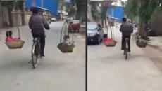 Dân mạng thót tim xem ông bố đi xe đạp gánh 2 con nhỏ