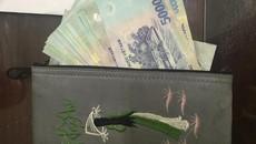 Bị dồn đuổi trên phố HN, tên cướp vứt lại túi có 30 triệu