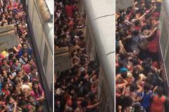 Kinh hoàng cảnh phụ nữ chen nhau lên tàu hỏa