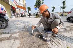 Hà Nội: Đề xuất dùng gạch giả đá lát vỉa hè