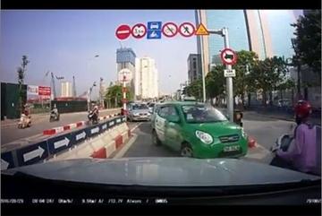 Hàng loạt ô tô, xe máy nối đuôi nhau vi phạm giao thông