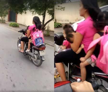 Người phụ nữ đèo 3 trẻ nhỏ, vừa lái xe một tay vừa cho con bú