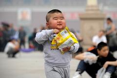 Cha mẹ Hổ Trung Quốc kiệt sức với mời gọi sinh con thứ 2