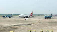 Cảnh cáo du khách Trung Quốc lục đồ người khác trên máy bay