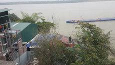 Yêu cầu phá dỡ công trình trái phép lấp sông Hồng
