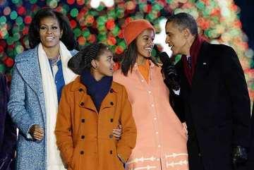 Những khoảnh khắc đáng nhớ bên vợ con của Obama