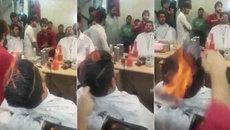 Thợ tóc nổi tiếng thế giới nhờ châm lửa trên đầu khách