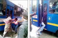 Bị kẹp giữa cửa xe buýt, gã móc túi đành thúc thủ