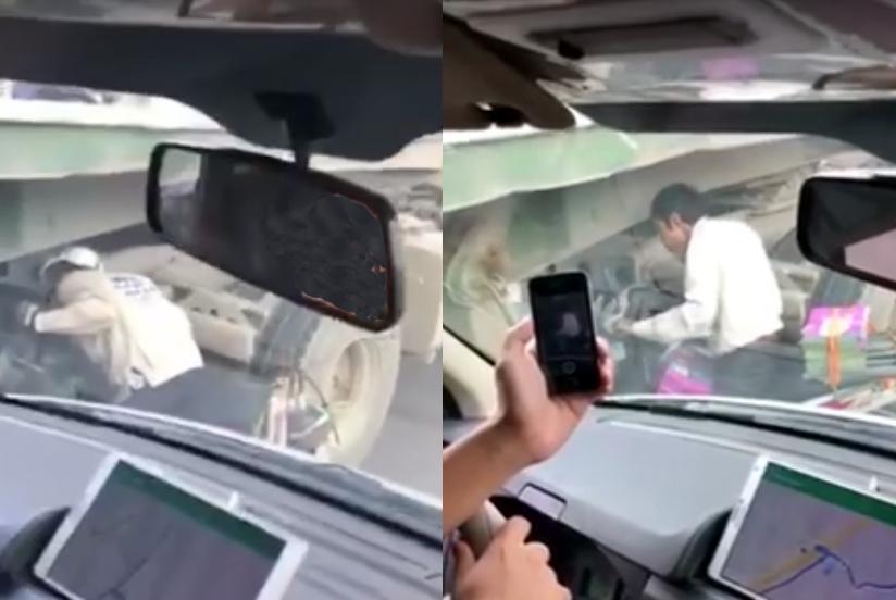 Khó tin: Xe máy sang đường bằng cách chui gầm xe tải