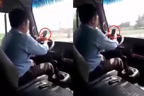 Vừa lái xe buýt vừa 'dán mắt' vào điện thoại trên quốc lộ