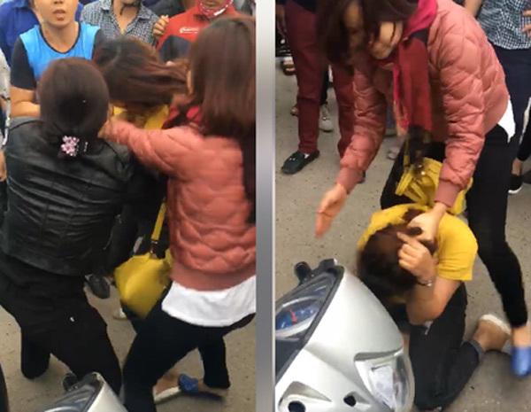 2 phụ nữ trèo lên nóc ô tô, đánh ghen ngay trên phố