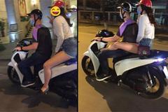 """Đi xe máy gác chân lên đùi bạn trai, dáng ngồi """"gây bão"""" của bạn gái trẻ"""