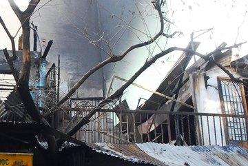 Xưởng may cháy ngùn ngụt, mẹ bế con 2 tuổi nhảy lầu
