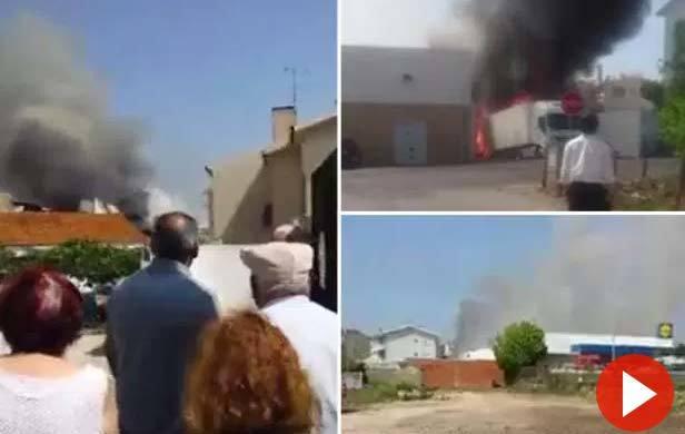 Máy bay phát nổ, lao xuống xe tải đậu ngoài siêu thị