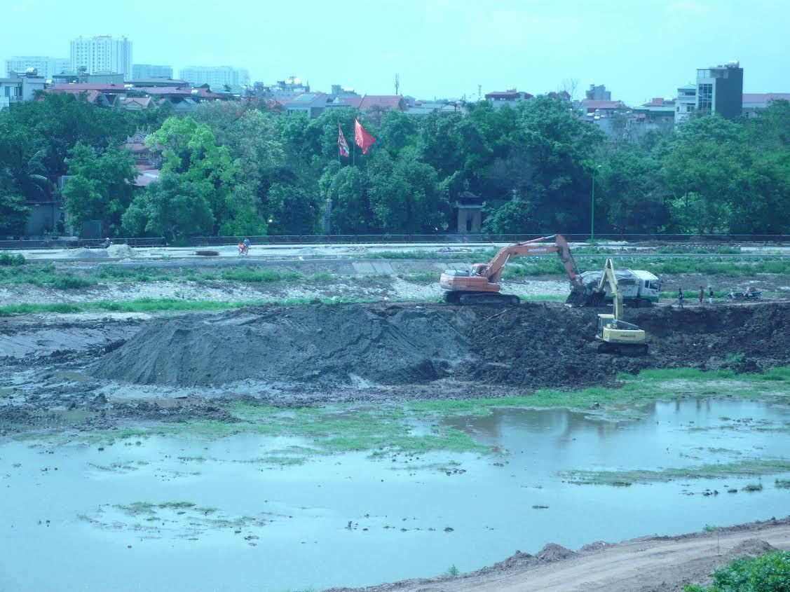 Bán sổ đỏ, bán đất sản xuất cho lò gạch, khai thác cát, hồ Định Công