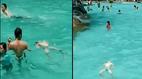 Bé trai bị đuối nước giữa bể bơi đông người