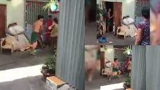 Xôn xao clip con trai cầm chổi đánh mẹ