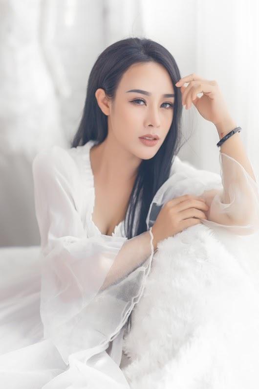 Vợ kém 19 tuổi của Việt Hoàn 3 con vẫn hấp dẫn