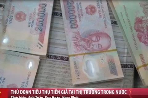 Thủ đoạn tiêu thụ tiền giả tại Việt Nam