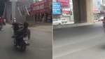Thanh niên nằm ngửa, lái xe máy bằng chân như làm xiếc trên phố