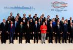Vì sao ông Trump không đứng gần bà Merkel trong ảnh lãnh đạo G20?