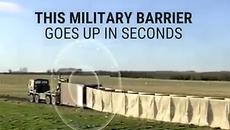 """Xem xe tải Mỹ """"nhả"""" rào chắn bảo vệ binh lính"""