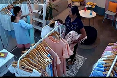 Người phụ nữ khoắng đồ shop, rải vỉa hè bán