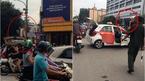 Bị CSGT dừng xe, tài xế taxi lên nóc xe 'ăn vạ'