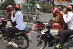 Cho thú cưng đi xe máy, người dân dễ bị phạt nặng