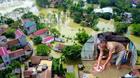 Vỡ đê Chương Mỹ: Người Hà Nội rửa bát, tắm giặt bằng nước lũ