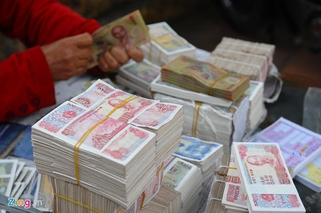 Đổi tiền mới lì xì: Mất 1 triệu được 800 ngàn