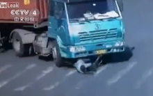 10 clip 'nóng': Thoát chết hy hữu dưới gầm xe container