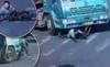 Thoát chết thần kỳ dù bị cuốn vào gầm xe tải