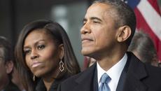 Thu nhập của vợ chồng Obama sụt giảm