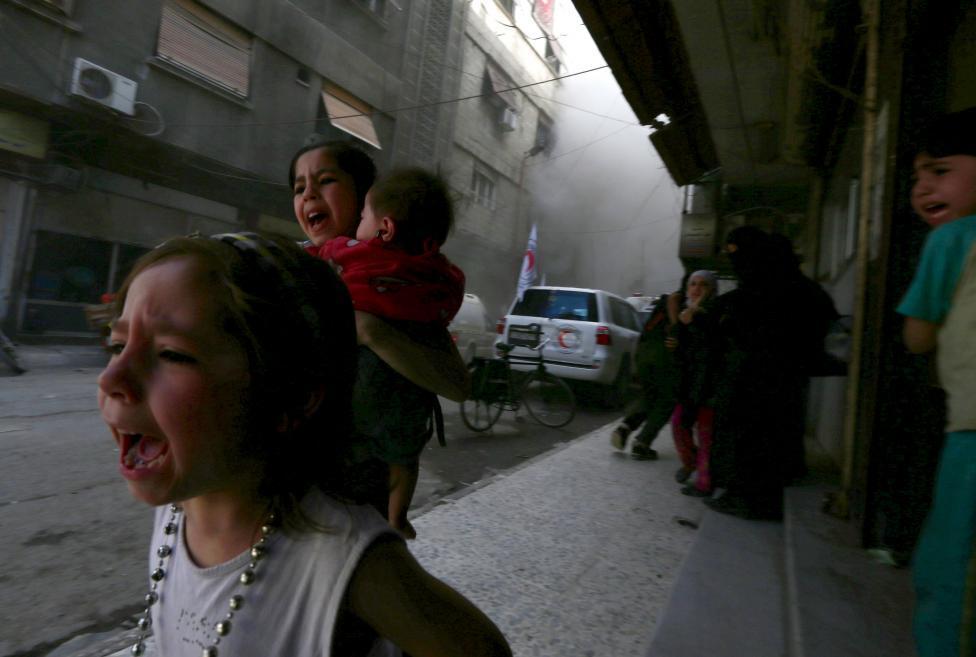 Ám ảnh gương mặt trẻ em trong chiến tranh tại Syria - 1