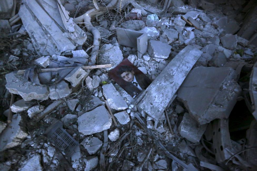 Ám ảnh gương mặt trẻ em trong chiến tranh tại Syria - 9