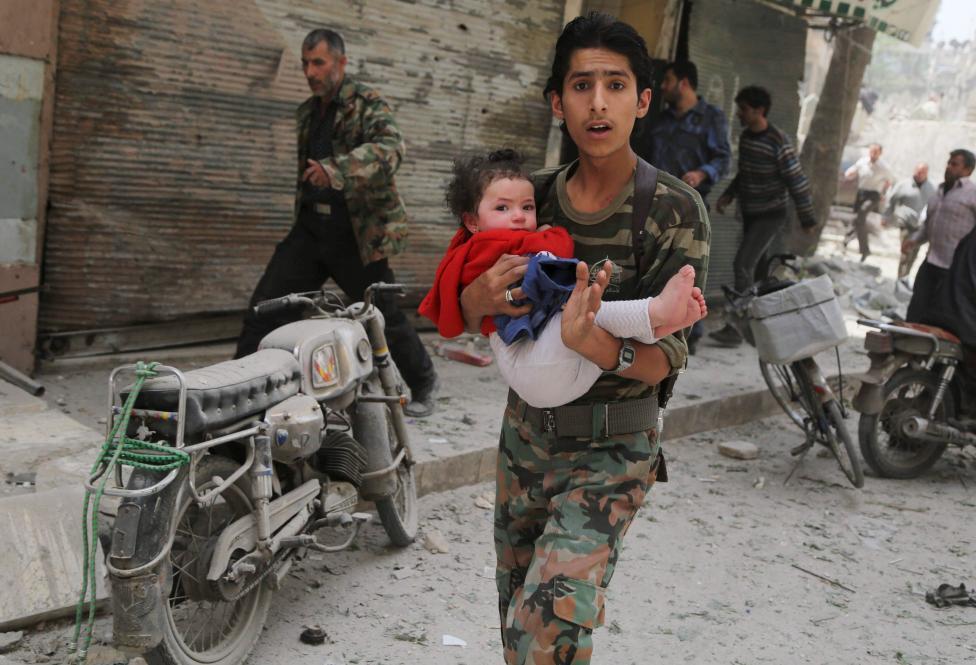 Ám ảnh gương mặt trẻ em trong chiến tranh tại Syria - 12