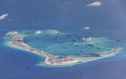 TQ ngang nhiên nói sắp hoàn tất 'cải tạo đảo' ở Biển Đông